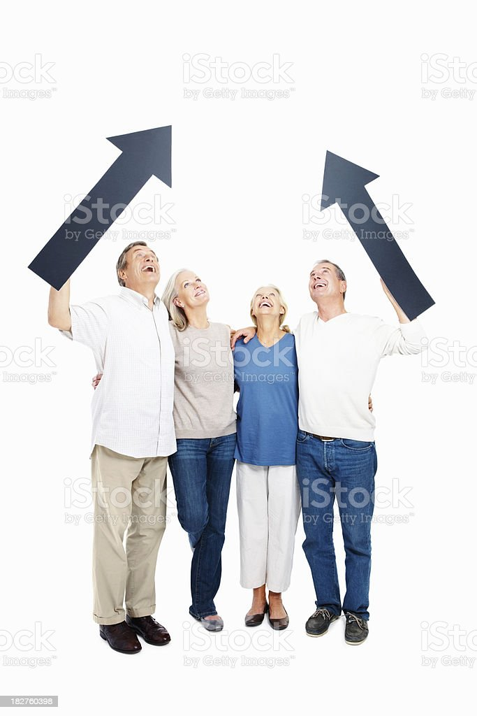Elderly couples holding up arrow signs to copyspace royalty-free stock photo