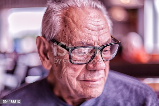 istock Elderly Dementia Man Waiting For Breakfast Looking Down 594488810
