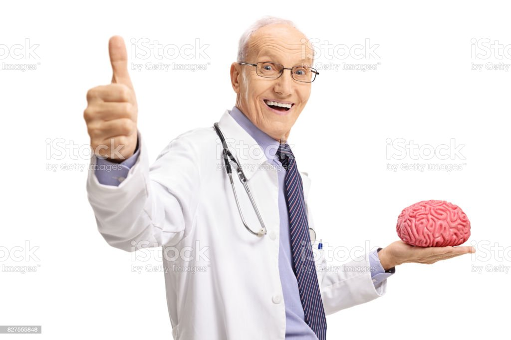 Elderly doctor holding brain model and making thumb up gesture stock photo