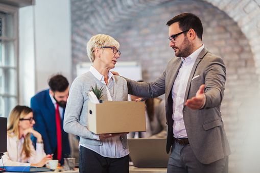 1048789678 istock photo Elderly employee leaving office with box full of belongings. Time to retire 1138643264