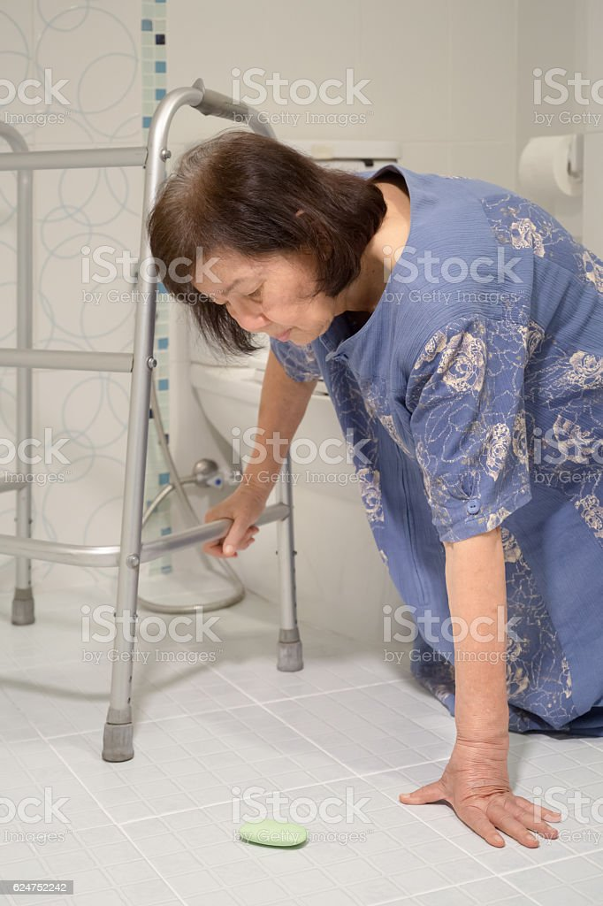 elderly falling in bathroom because slippery surfaces stock photo