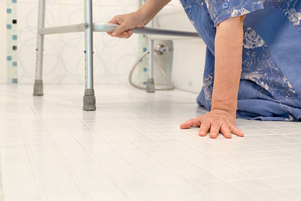 elderly falling in bathroom stock photo
