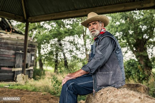 Elderly Farmer Sitting Waiting Stock Photo & More Pictures of 2015