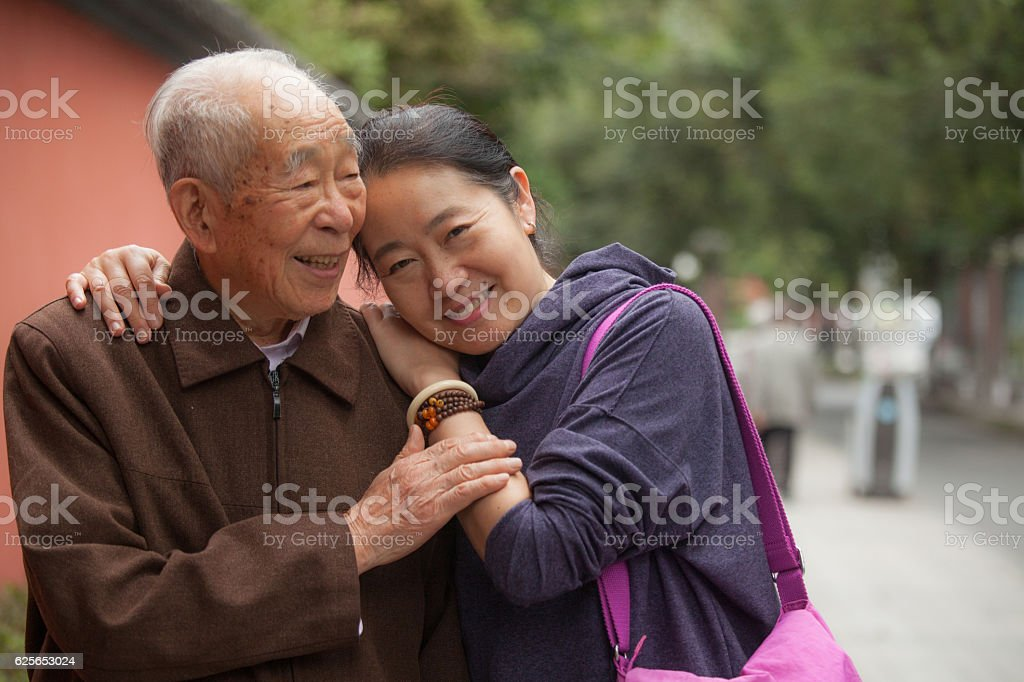 Elderly father and his middle aged daughter stock photo