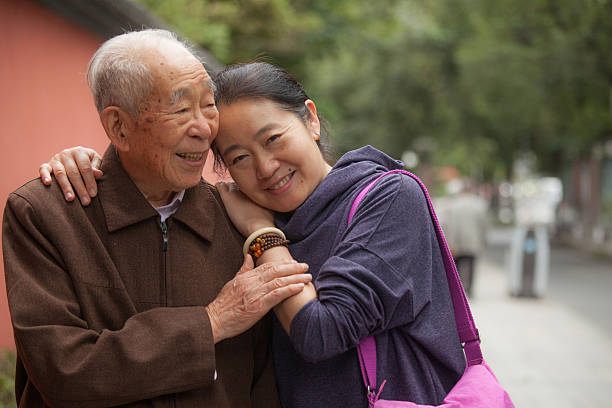 Elderly father and his middle aged daughter - Photo
