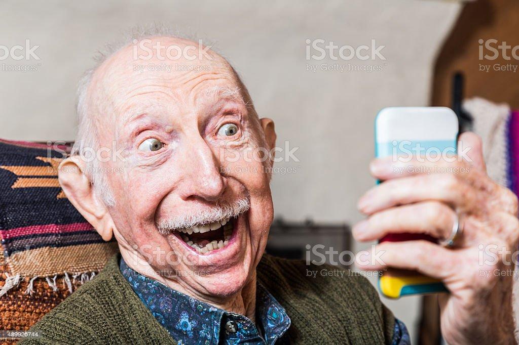Elderly Gentleman with Smartphone stock photo