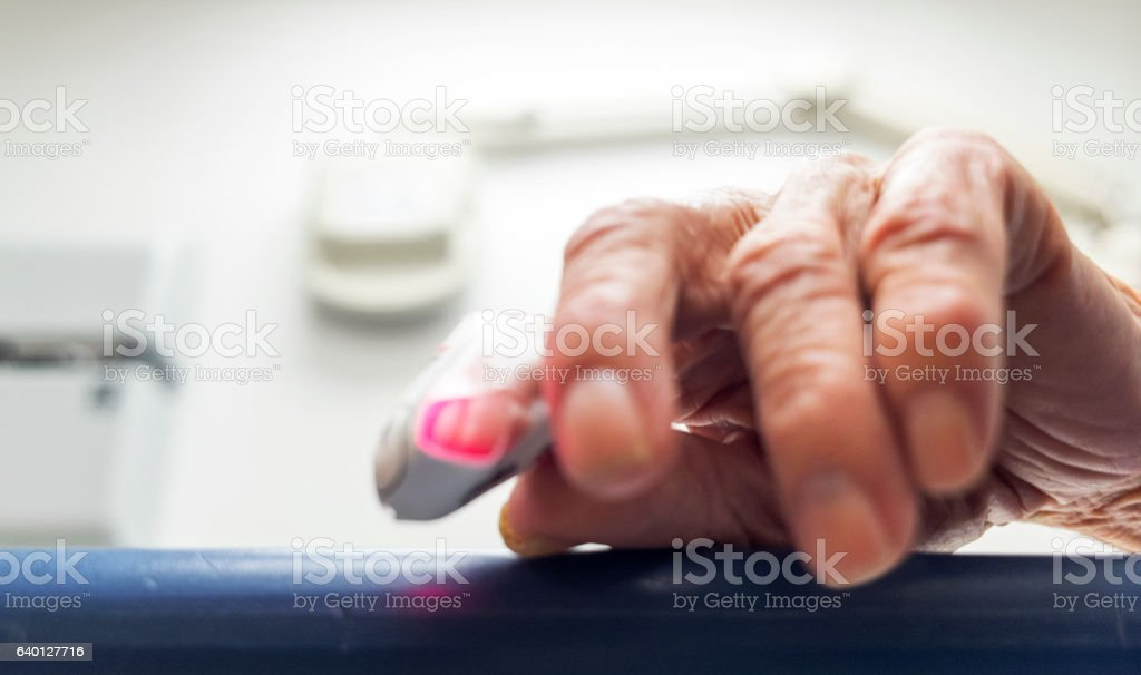 Elderly hand with a pulse meter. stock photo