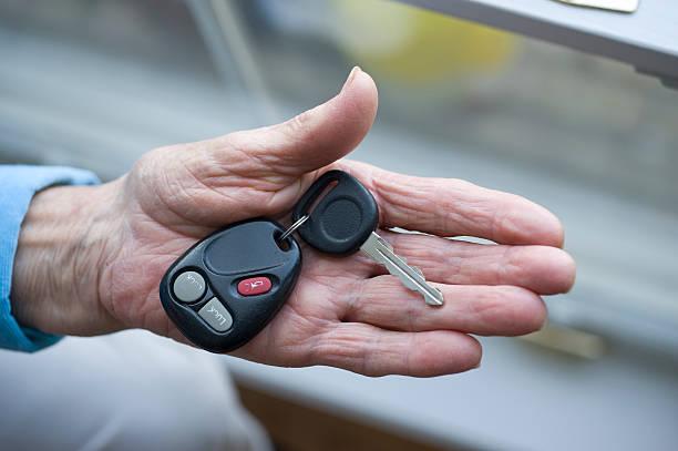 Elderly hand with car keys stock photo