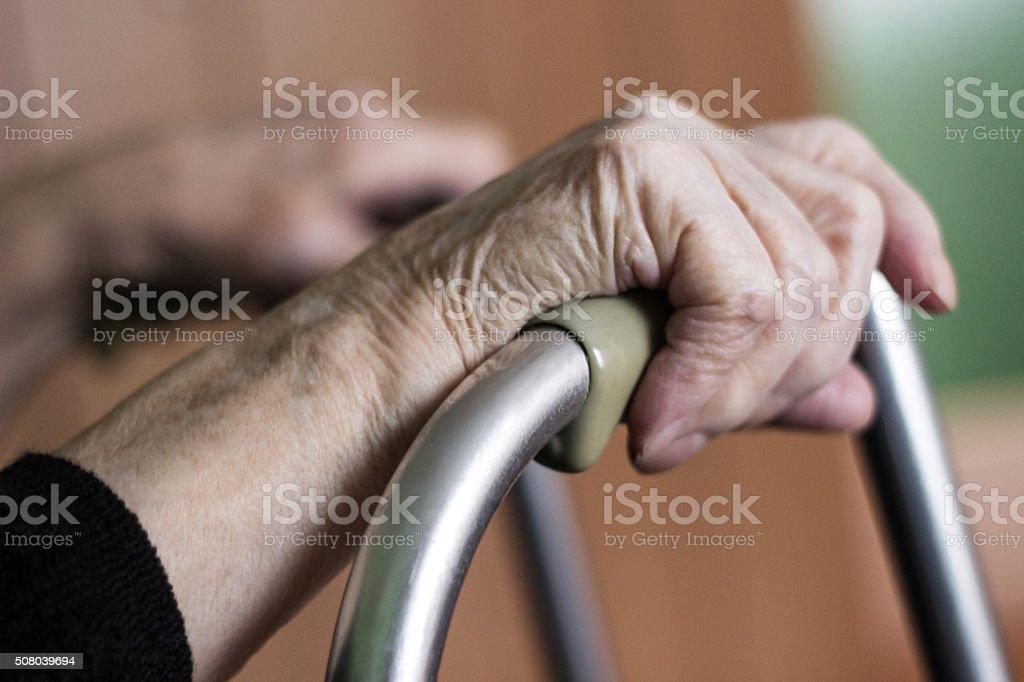 Elderly hands on a walker royalty-free stock photo