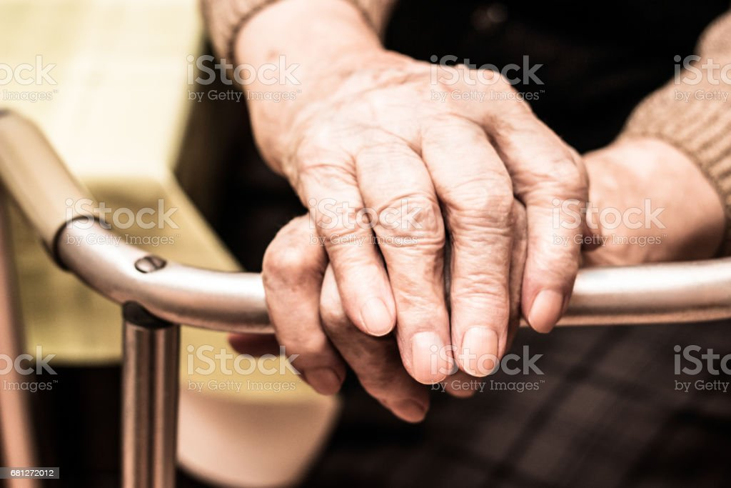 Elderly hands on a walker royalty-free stock photo
