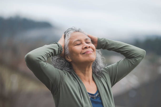 elderly hawaii woman practicing yoga - mindfulness stock photos and pictures