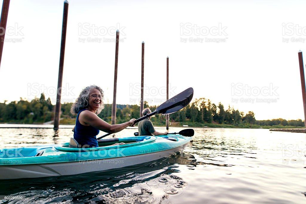 Elderly heterosexual couple enjoying some kayaking stock photo