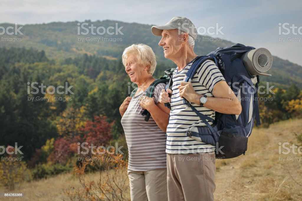 Elderly hikers looking away outdoors royalty-free stock photo