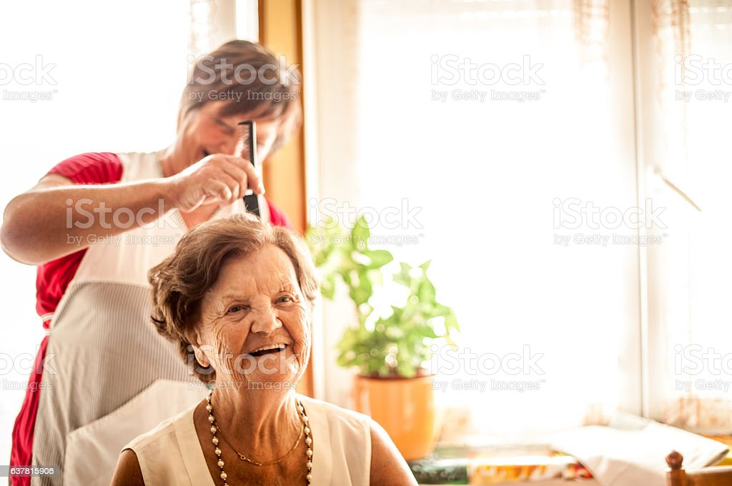 Elderly Home care service by a Caregiver stock photo