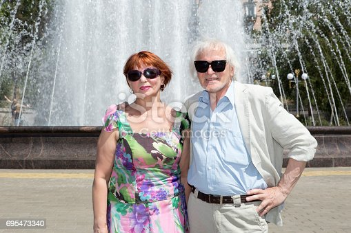 452783143istockphoto Elderly husband and wife for a walk 695473340