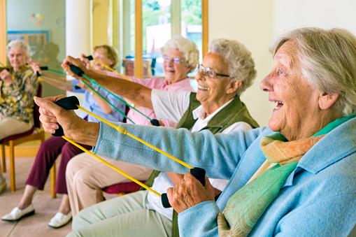 Elderly Ladies Exercising In A Gym-foton och fler bilder på Aerobics
