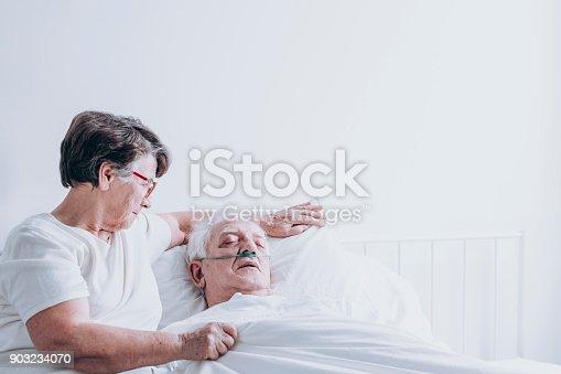 909569706 istock photo Elderly lady comforting her husband 903234070