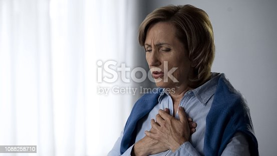 istock Elderly lady having asthma attack symptoms, hard to breath and pain in chest 1088258710
