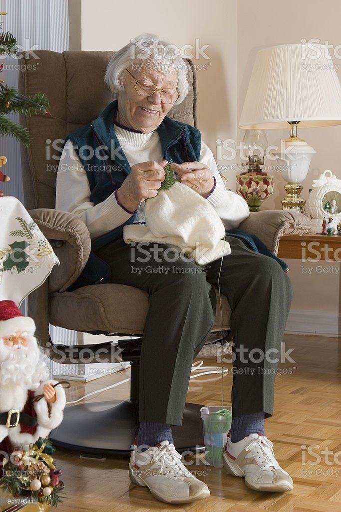 Elderly lady knitting royalty-free stock photo