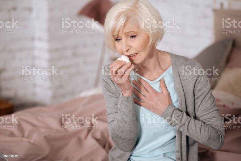 Elderly lady sick woman feeling bad stock photo