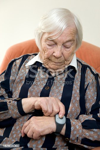 istock Elderly lady using emergency call system 182904060