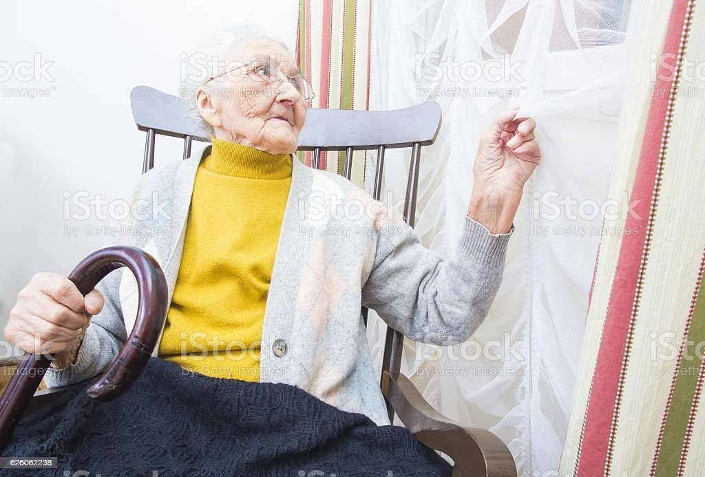 Elderly lady waiting for visitors stock photo