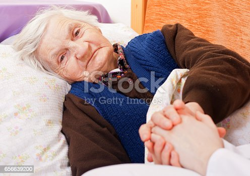istock Elderly lonely woman rests in the bed 656639200