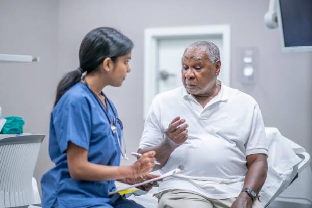 Elderly Male Patient Talking with Female Doctor stock photo stock photo