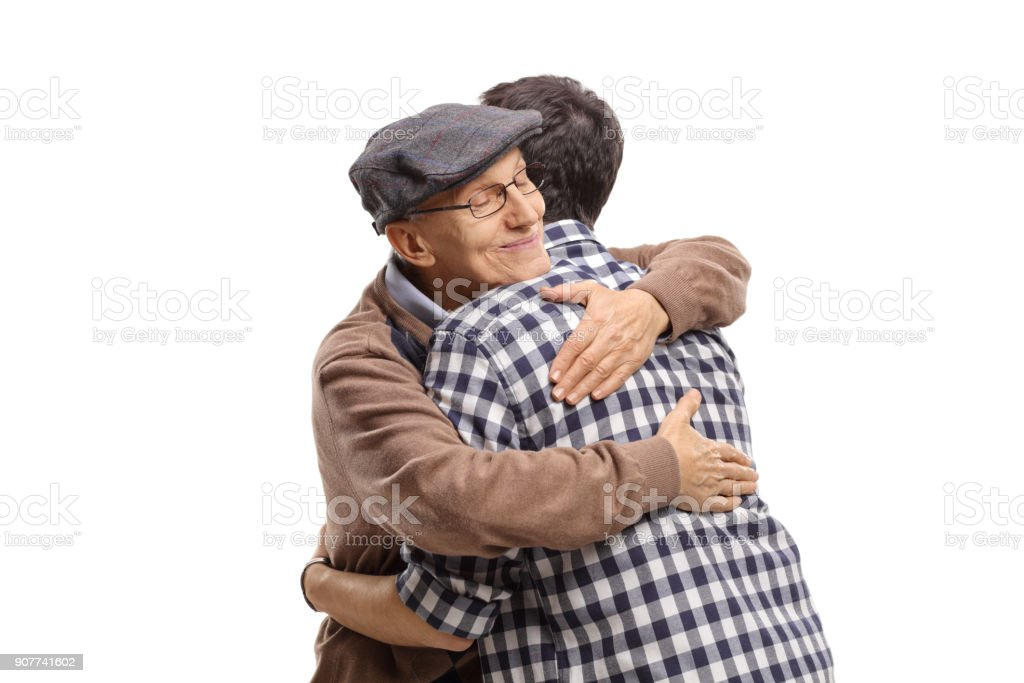 Elderly man and a young man hugging each other stock photo