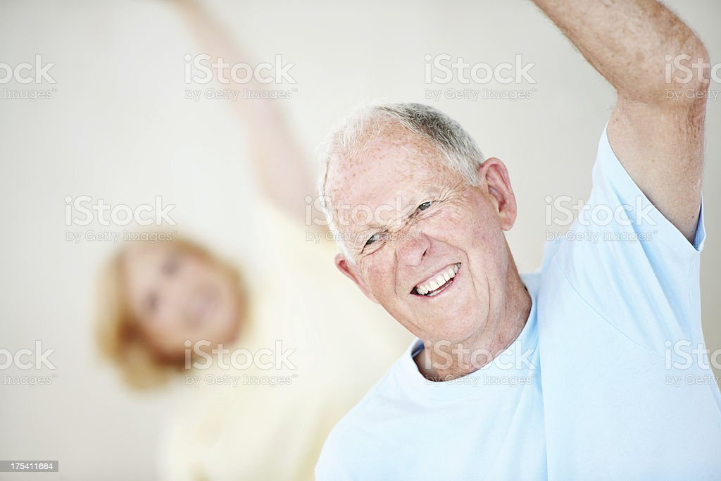 Elderly man and woman in yoga class royalty-free stock photo