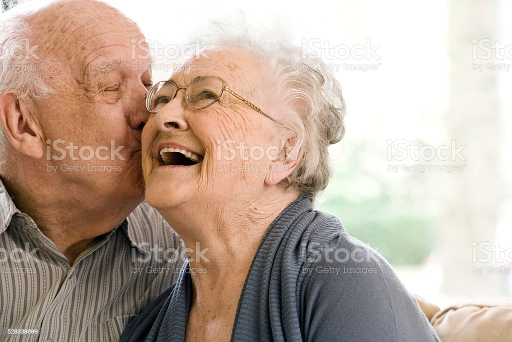 Elderly Man and Woman on Couch in Nursing Home stock photo