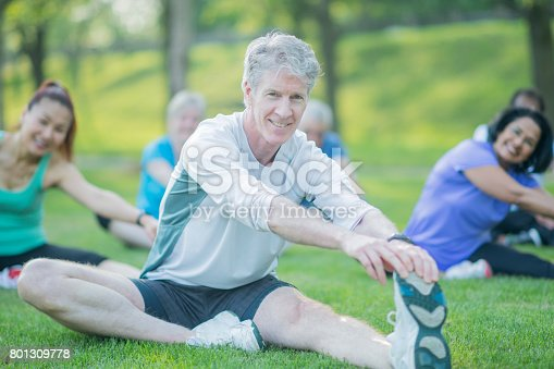istock Elderly Man Excercises with Group 801309778