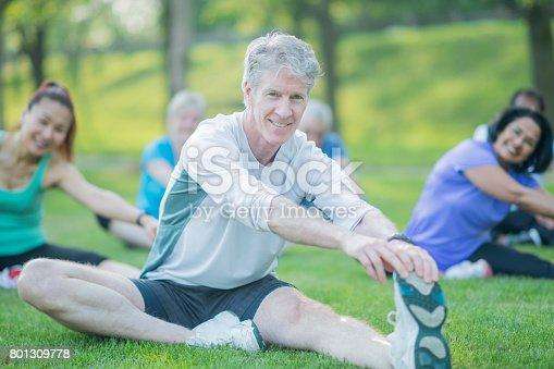 646614234 istock photo Elderly Man Excercises with Group 801309778