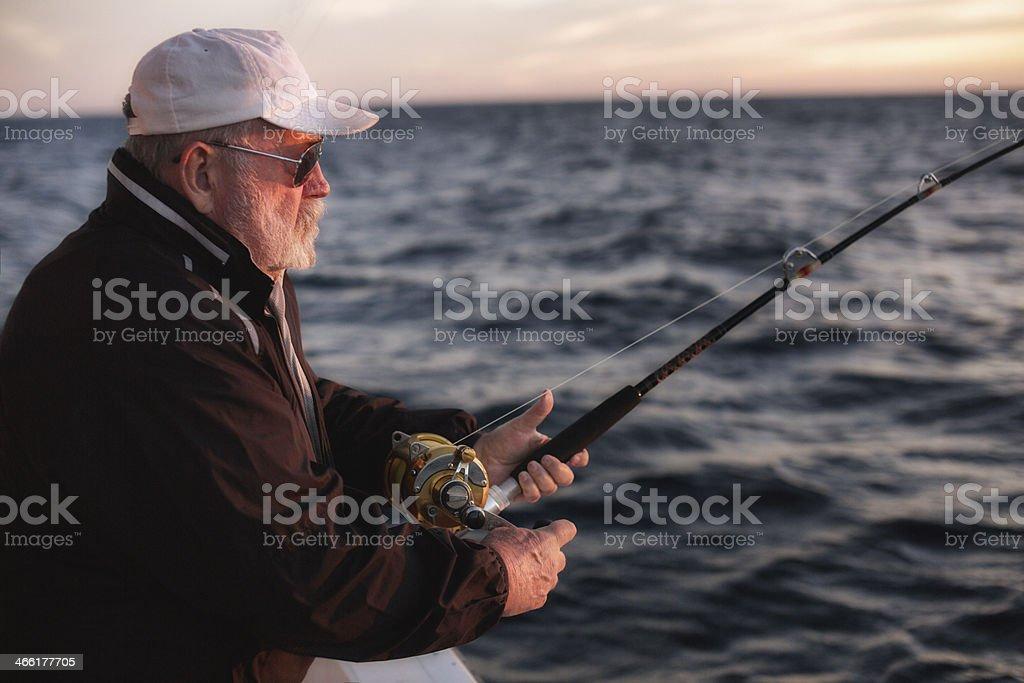 Elderly Man Fishing royalty-free stock photo