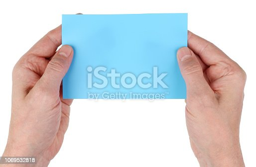 844190384 istock photo Elderly man grandfather holding empty blue paper page  card in hands. Isolated 1069532818