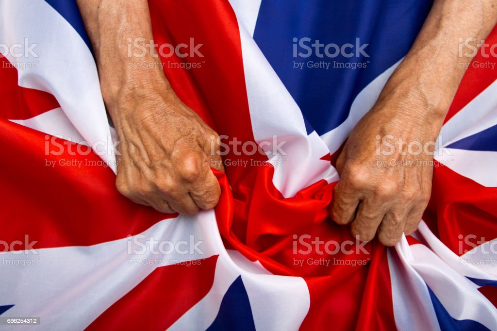 Elderly Man Hands Holding A Uk Flag The Concept Of Caring