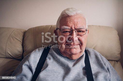 istock Elderly Man Happy at Home 665804840