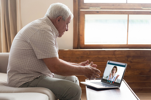 istock Elderly man have video call with doctor at home 1220117744