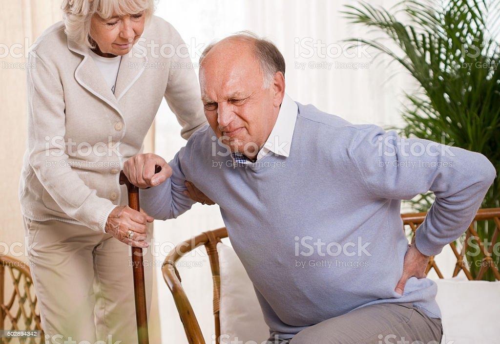 Elderly man having a back pain stok fotoğrafı