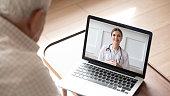 istock Elderly man having online video consultation with doctor 1205448274