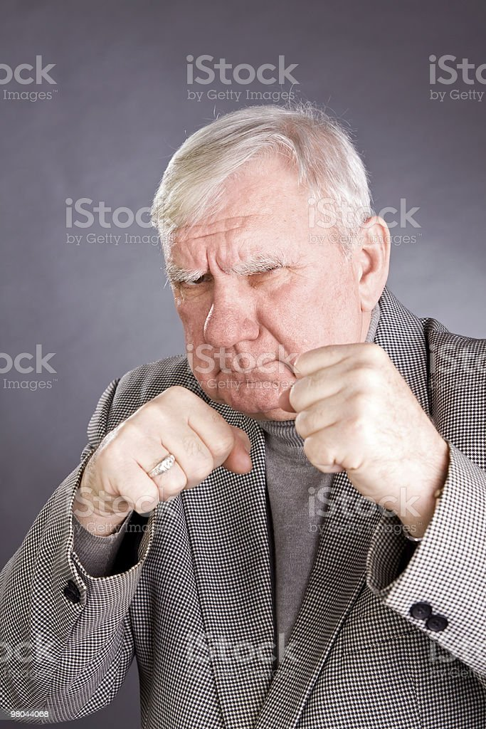 Elderly man in a pose of boxer royalty-free stock photo