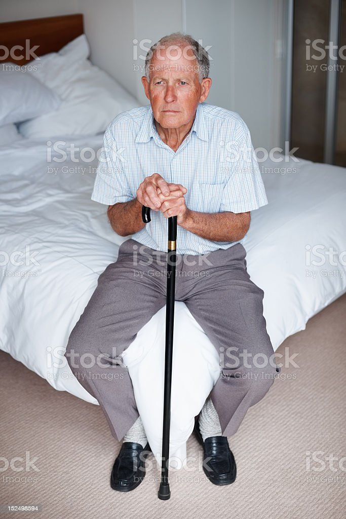 Elderly man in a thoughtful mood royalty-free stock photo