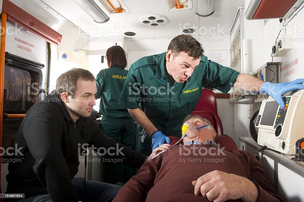 Elderly man in ambulance stock photo