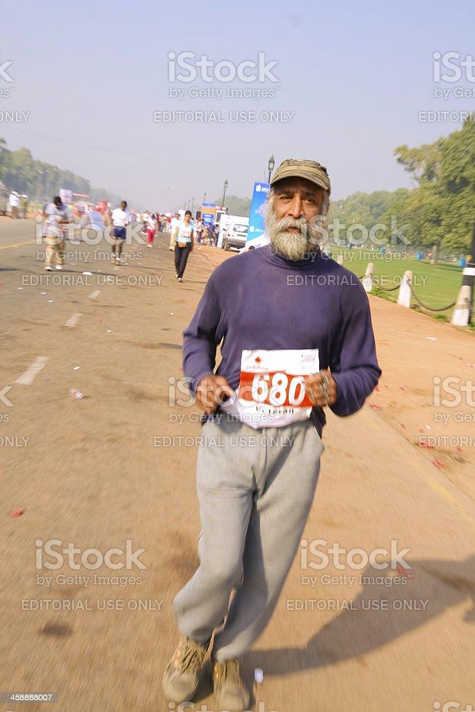 Elderly man in marathon royalty-free stock photo