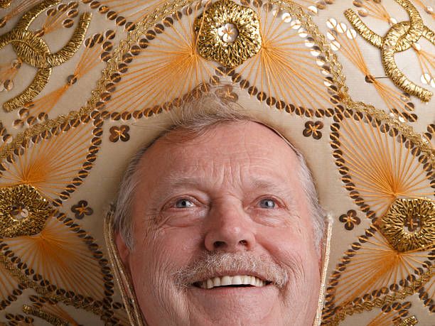 Elderly man in mexican sombrero, looking happy stock photo