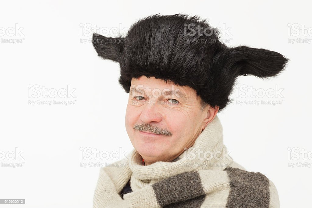 elderly man in warm fur hat with earflaps. stock photo