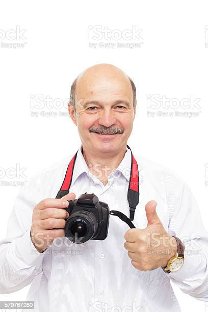 Elderly man is holding a camera and shows thumb up picture id579767260?b=1&k=6&m=579767260&s=612x612&h=a5ziqd0k2k4b1bkai4zddus hmdiqogkbv66upvhctw=