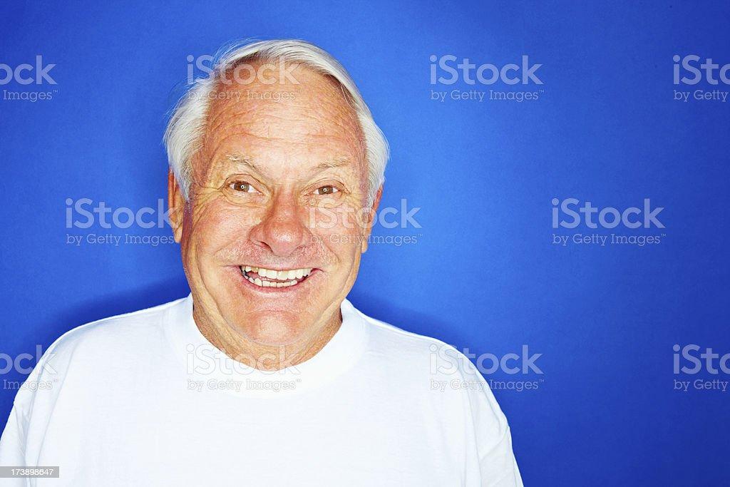 Elderly man isolated against blue background royalty-free stock photo