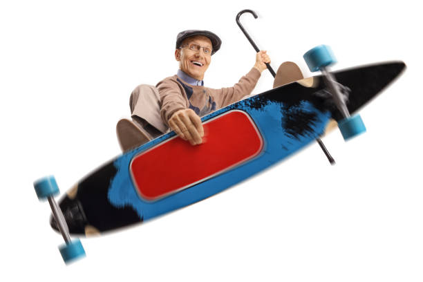 Elderly man jumping with a longboard Elderly man jumping with a longboard isolated on white background young at heart stock pictures, royalty-free photos & images