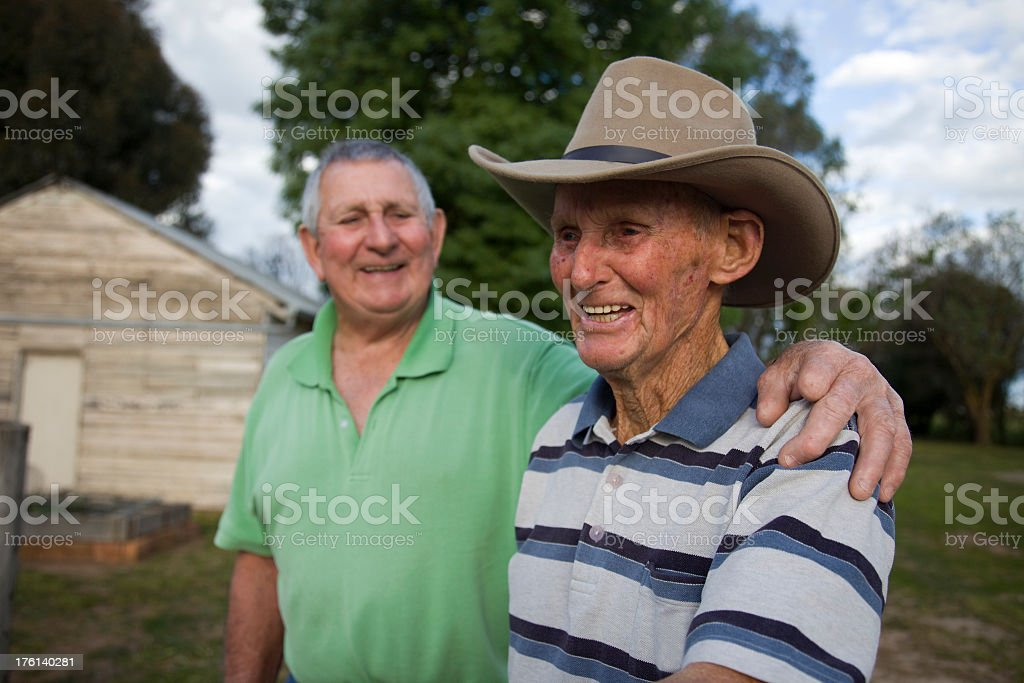 Elderly Man laughing with his younger brother stock photo